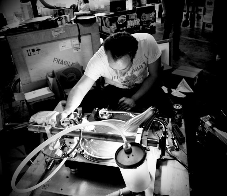 Ted Riederer cuts vinyl at Never Records