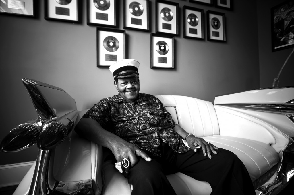 Fats Domino poses on his pink cadillac couch at his Westbank home