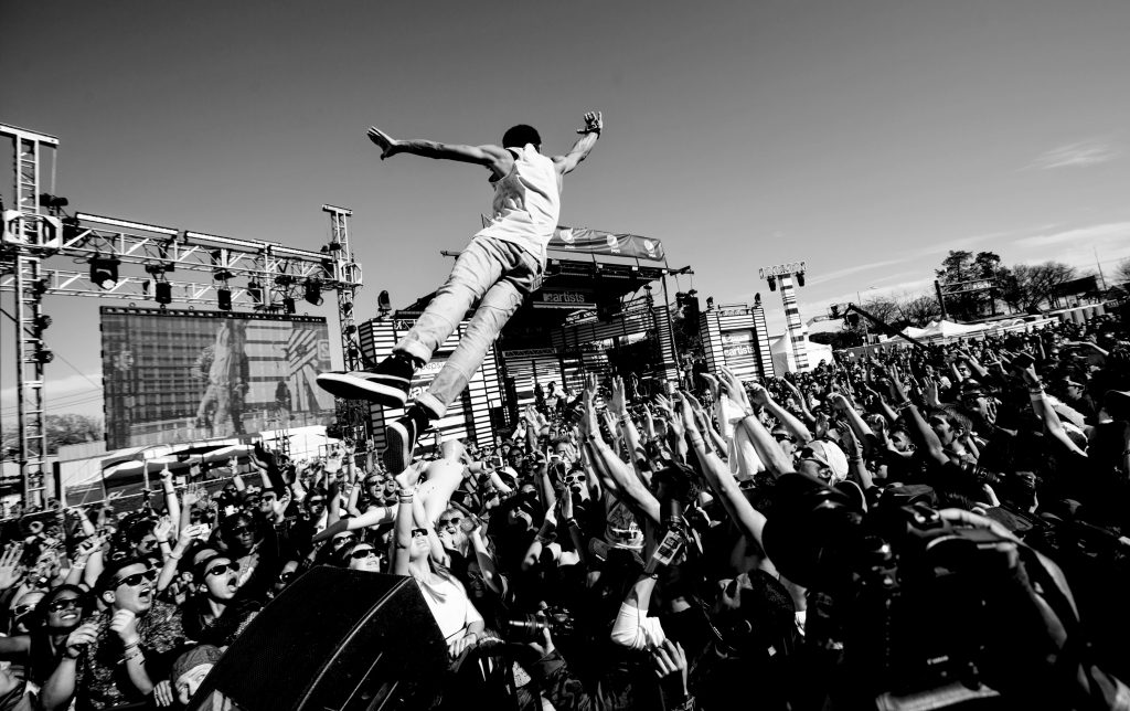Vic Mensa leaps into the crowd at the MTV Woodie Awards during SXSW