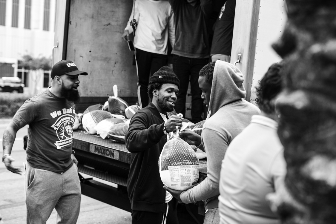 Gregoire Tillery and Curren$y give away turkeys outside of We Dat's Chicken & Shrimp on Canal St. (Patrick Melon)